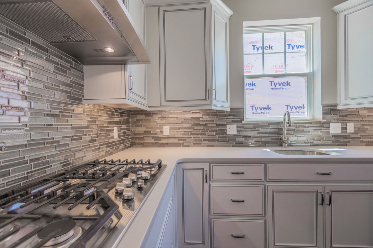 stove and sink in a kitchen of a Berks County home for sale