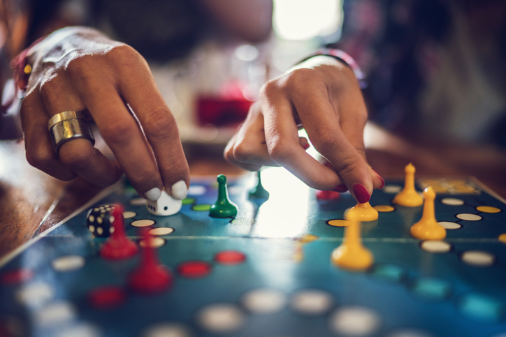 Close up of people playing cross and circle game.