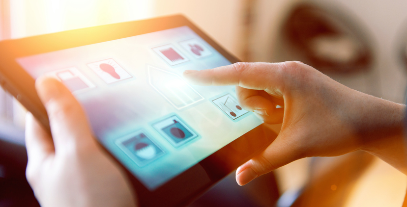 Womans controls Internet of Things in smart home with app