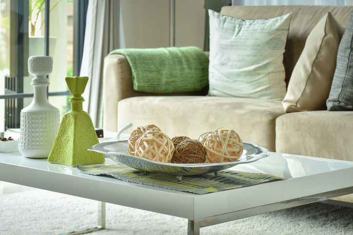 Ratten balls and vases on table with light brown sofa