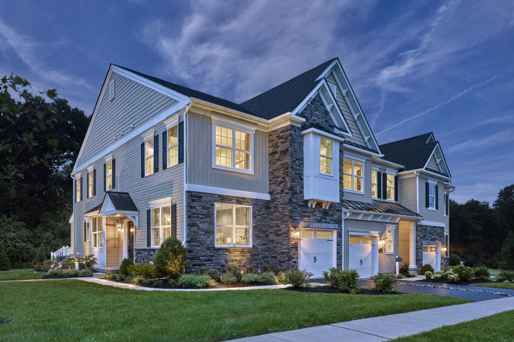 Photo of Exterior Townhome at The Reserve at Glen Loch at twilight.