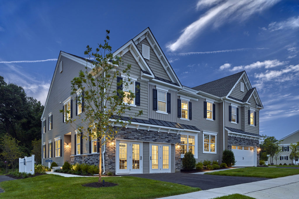 Exterior photo of carriage homes at The Reserve at Glen Loch at twilight.