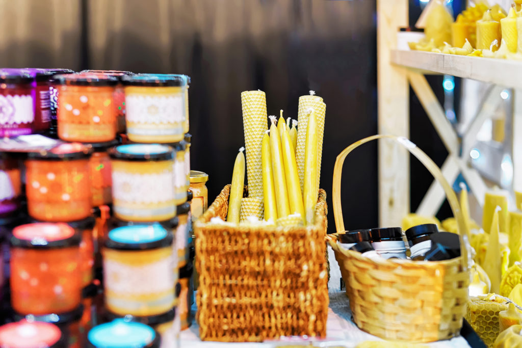 Stall with festive wax candles at a Market.