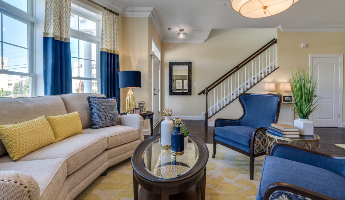 Wrap around couch in model townhome at Siena Place in Philadelphia, PA
