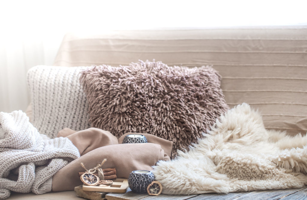 Hygge decor, cozy pillows and blankets