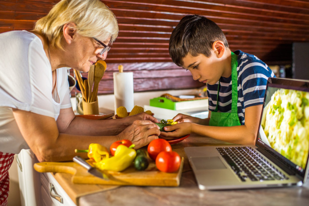 People using online cooking resources together