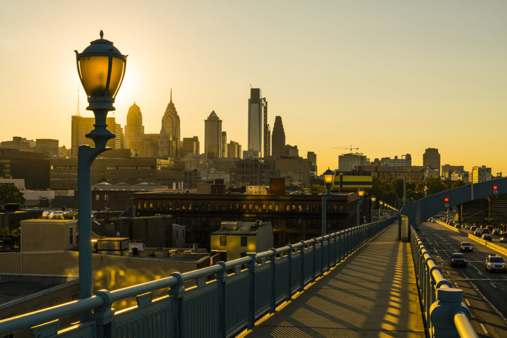 Philadelpia Downtown at sunset. The view from the Benjamin Franklin Bridge.