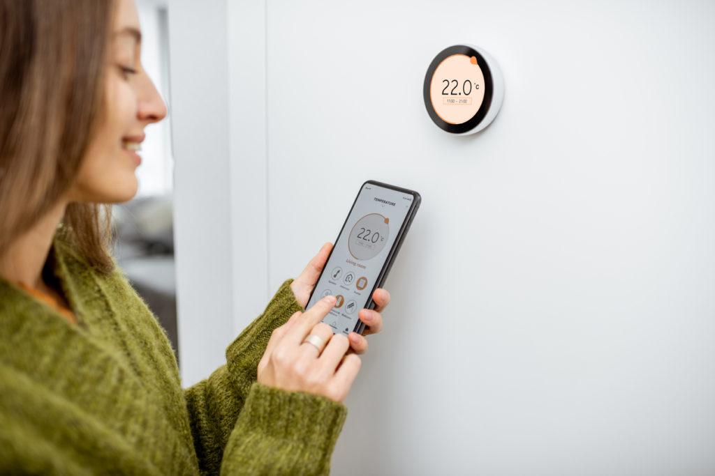Woman using smart home technology