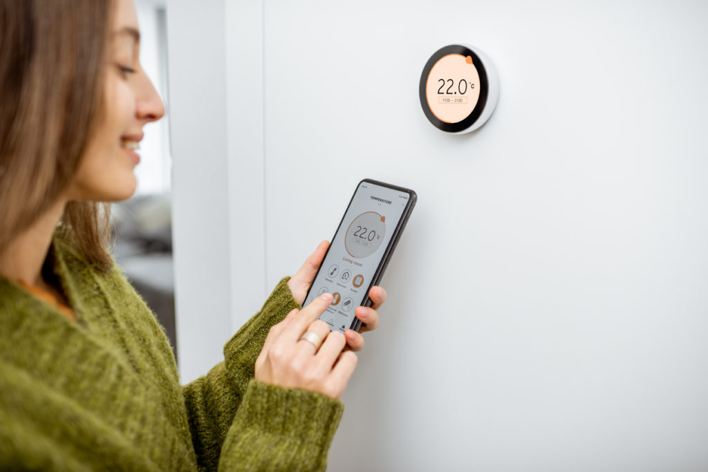 Woman using smart home technology